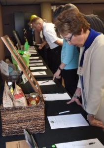 Understanding the Times: Guests consider their bids at the 2016 Silent Auction